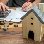 One spouse checking finances before applying for a mortgage